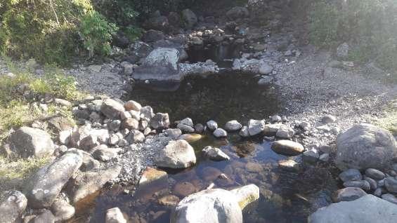 Fotos de Una hectarea con mil quinientos metros, agua viva, 2 cabañas, tituladas 6